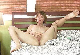 Mature female toys Her pink vagina for the camera