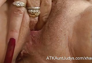 Hairy Grannie Vibrating Her Wet gash In the Office