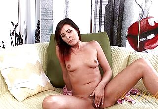 Hairy mature Woman opens up Her Beaver On couch